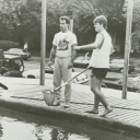 """John Coghlon and Darin Coopreider clean the pool before the """"evening in paradise."""""""