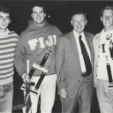Carrying their trophies for intramurals. Left to right: Tim Condon, Bill Reid, Dr. Richard Grace, and Mike Insico
